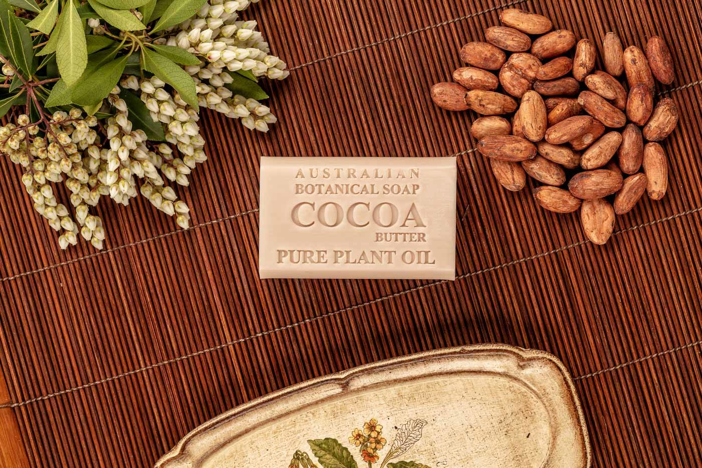 Australian Botanic Soap Cocoa with bean on bamboo mat over the top view