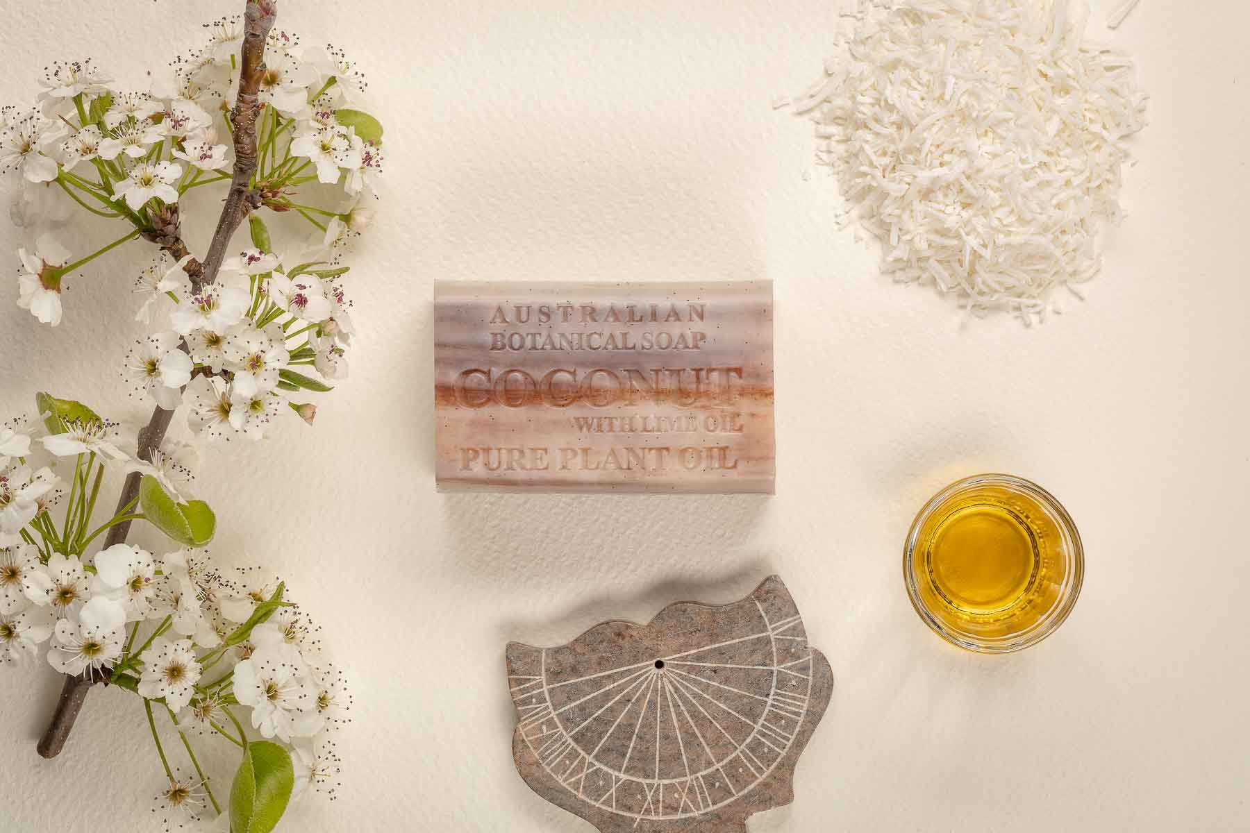 Australian Botanic Soap Coconut with oil and sun watch over the top view - Lifestyle advertising product photo
