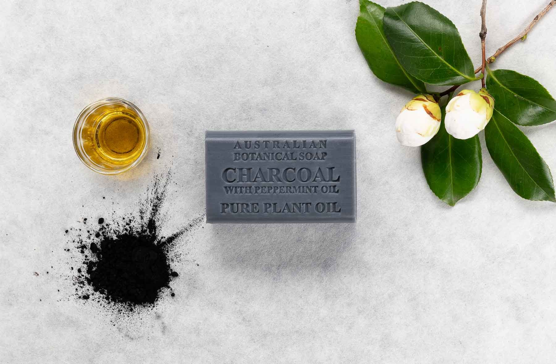 Australian Botanical Soap charcoal with charcoal and oil over the top view - Lifestyle advertising product photo
