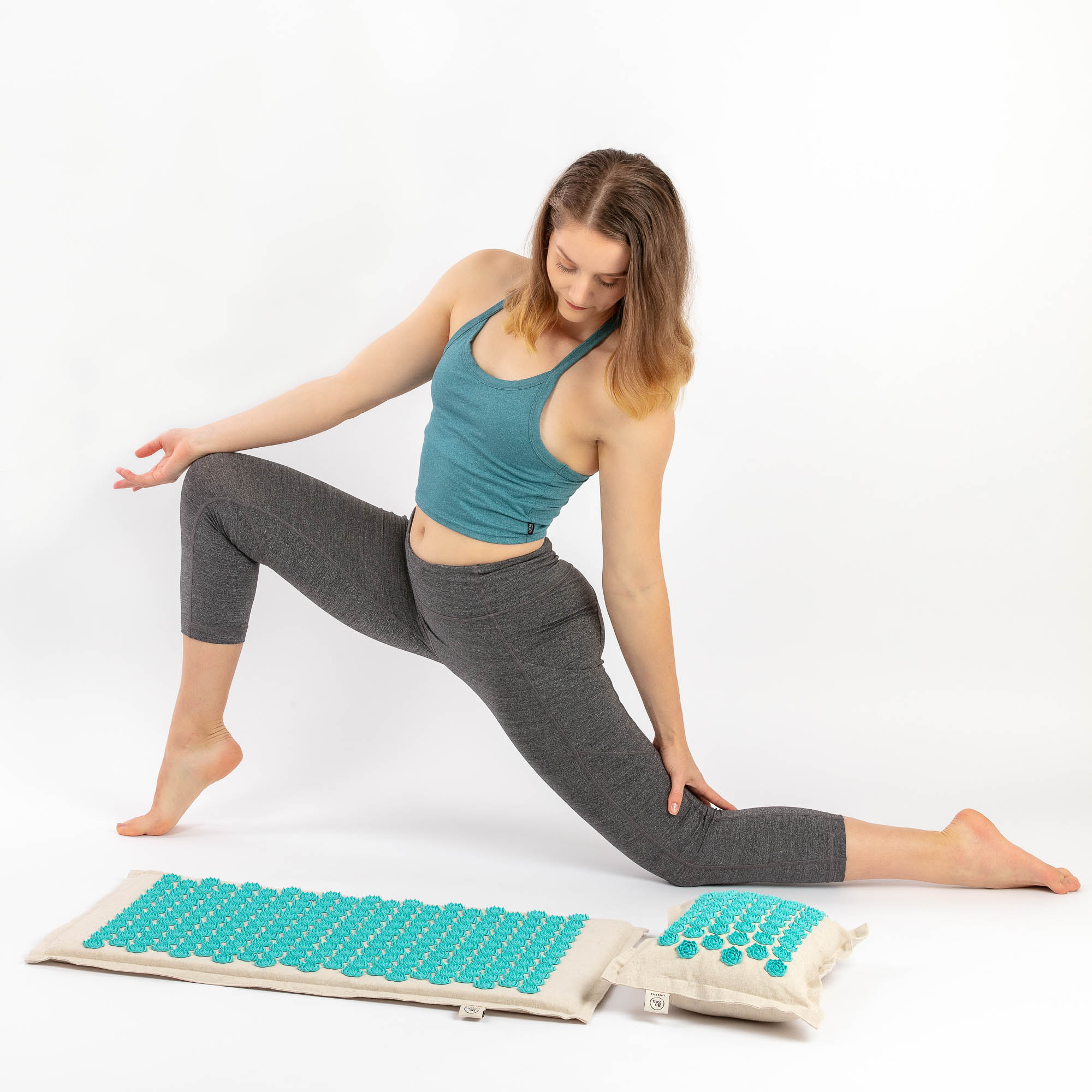 Be Zen exercise on side of mat - Lifestyle product photography with model