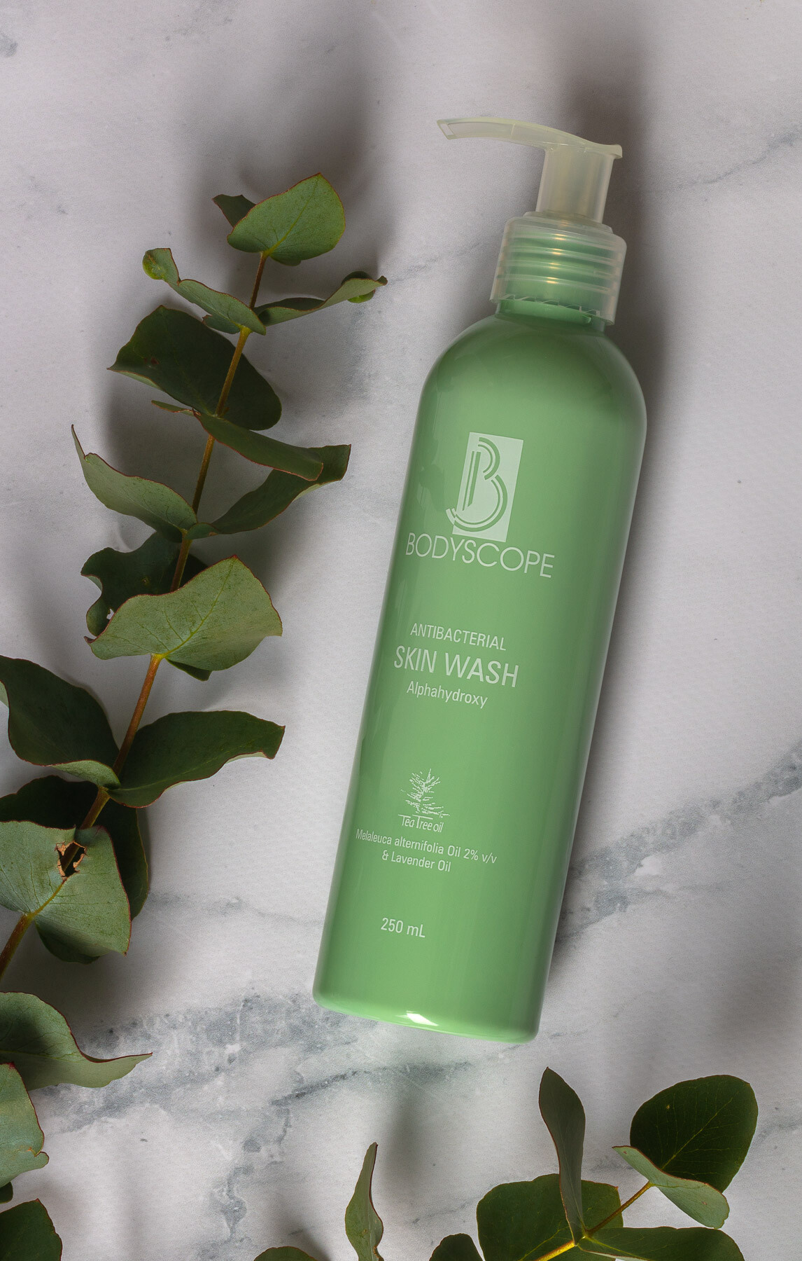 Body Scope Lifestyle Skin Wash on marble with leaves - Advertising product photography for website