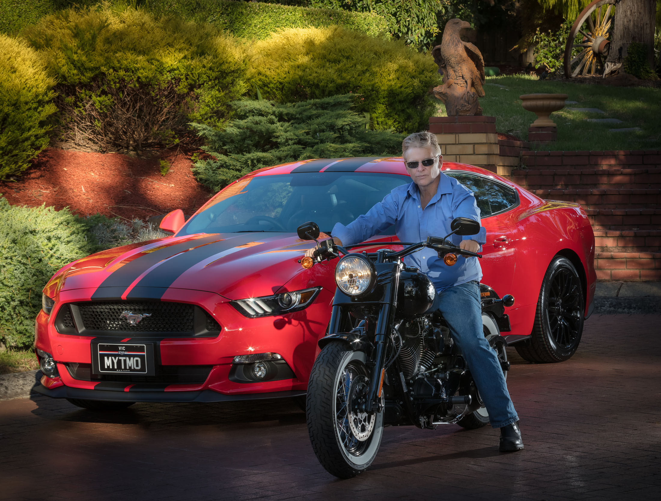 Environment portrait of John and his motorcycle and Mustang 2