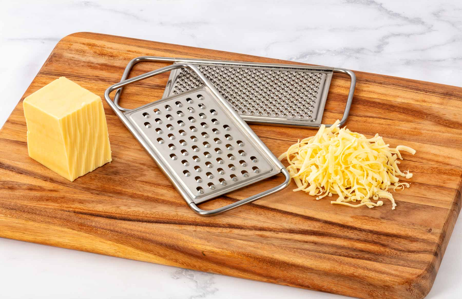 Forever Sharp-Cheese grater on timber board - lifestyle product photography