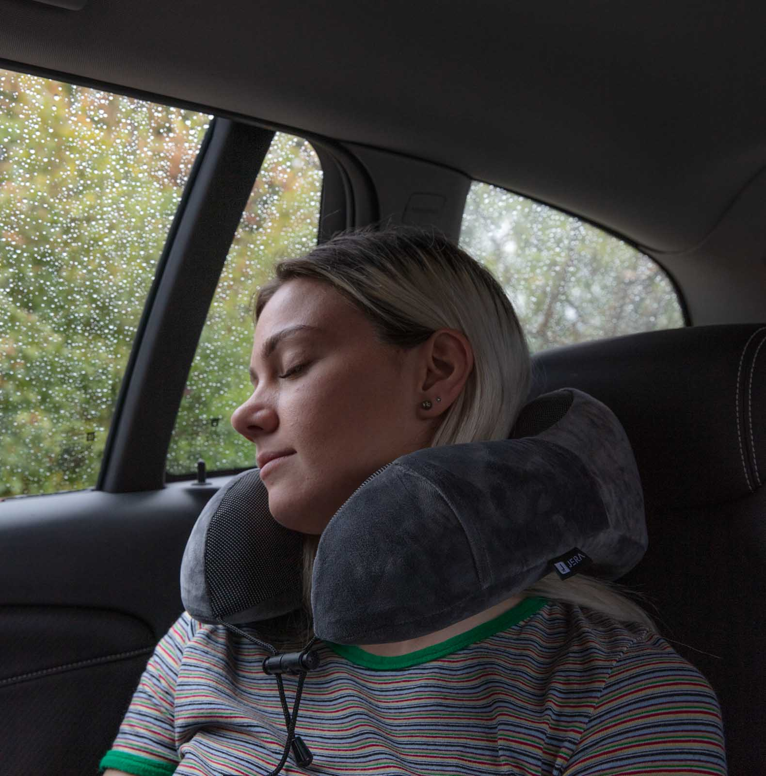 Jera travel pillow advertising photo of girl sleeping in car during day - Sample Amazon Product photography