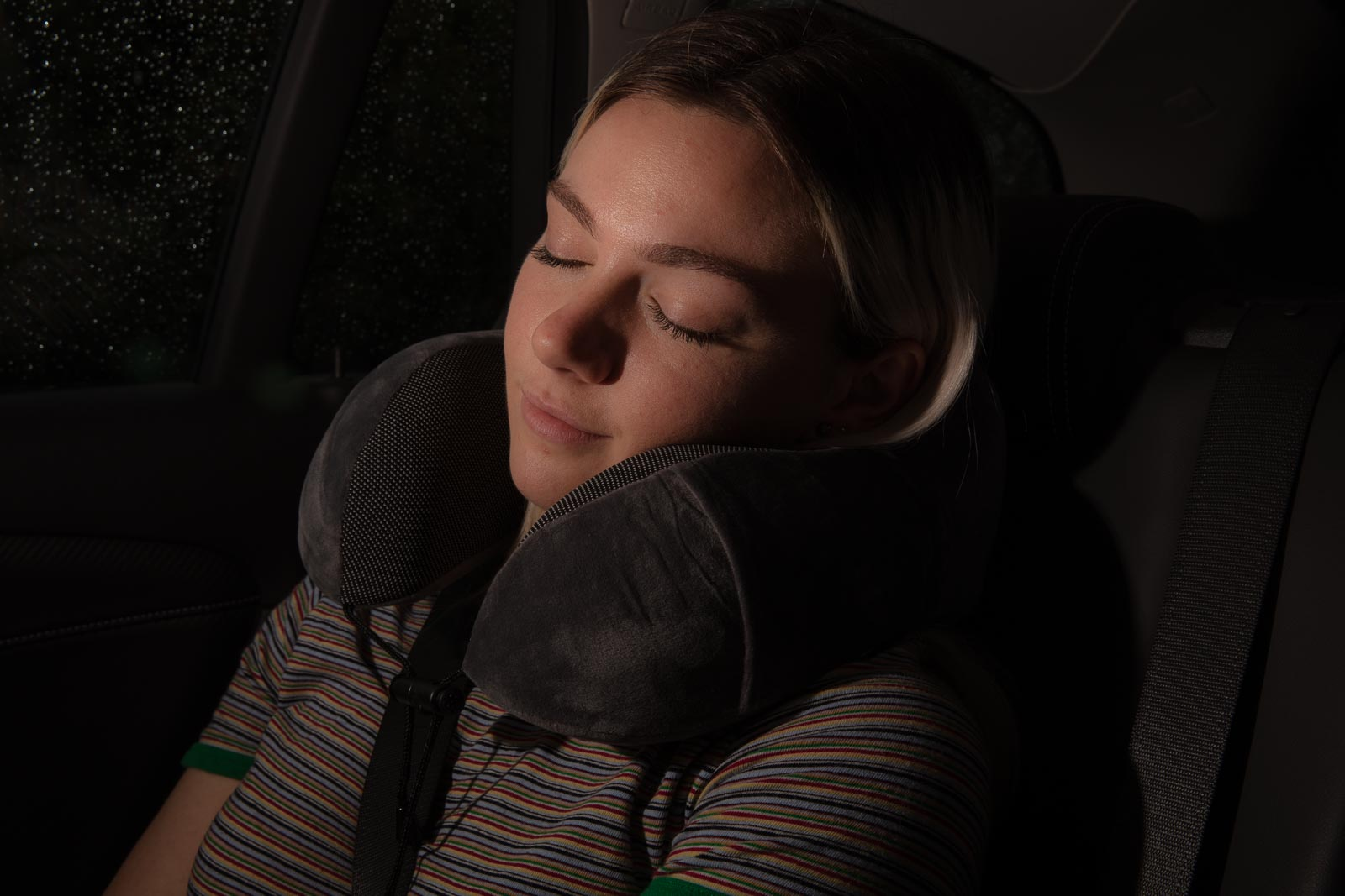 Jera travel pillow advertising photo of girl sleeping in car during night - Sample Amazon Product photography.jpg