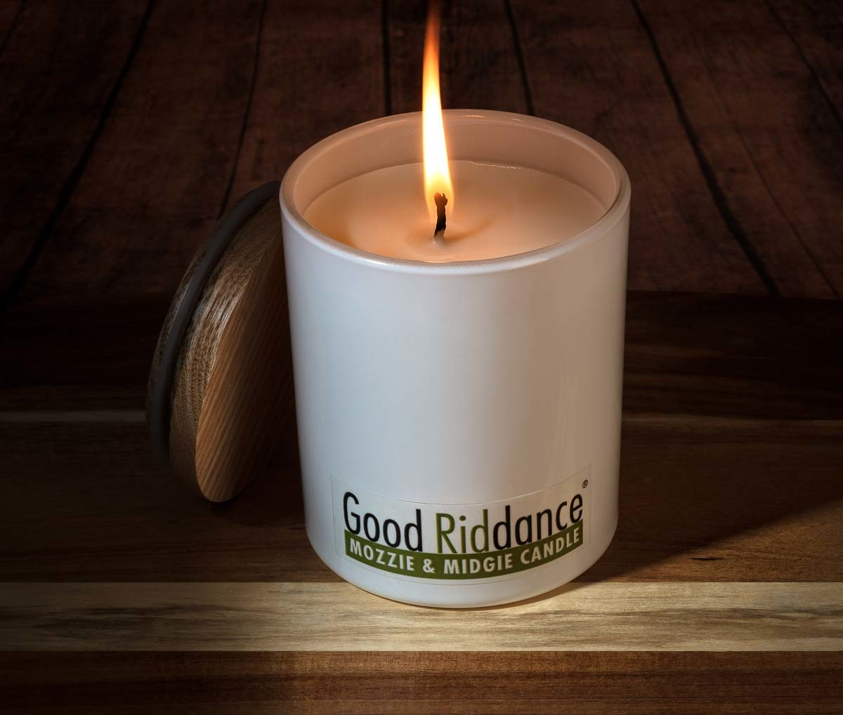 Mosquito repellent products_Natural Wonders Outdoor Candle on timber deck