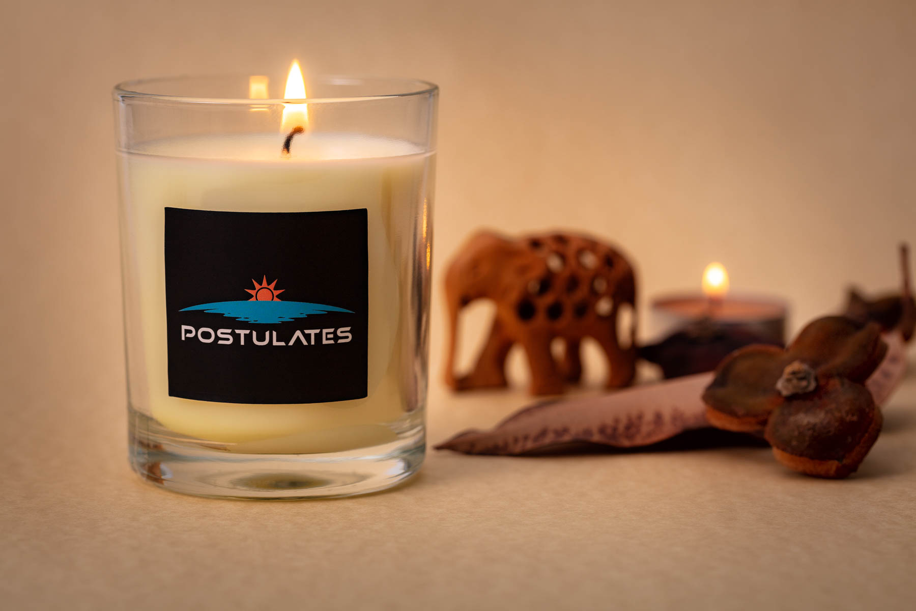 Postulate white candle lifestyle product phtoography