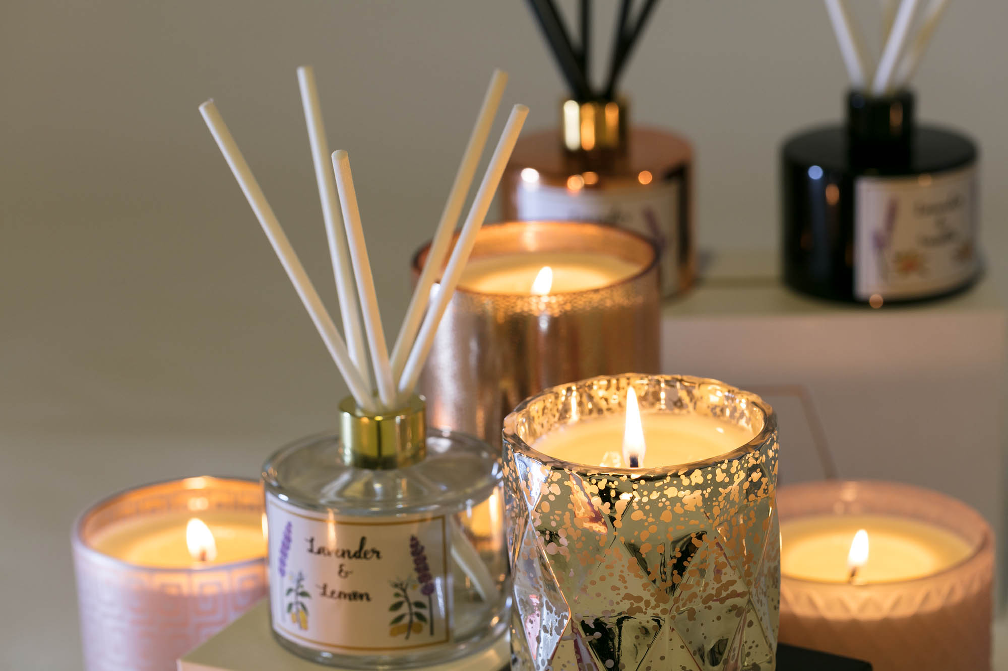Product photography of diffusers and candles group lit afternoon look