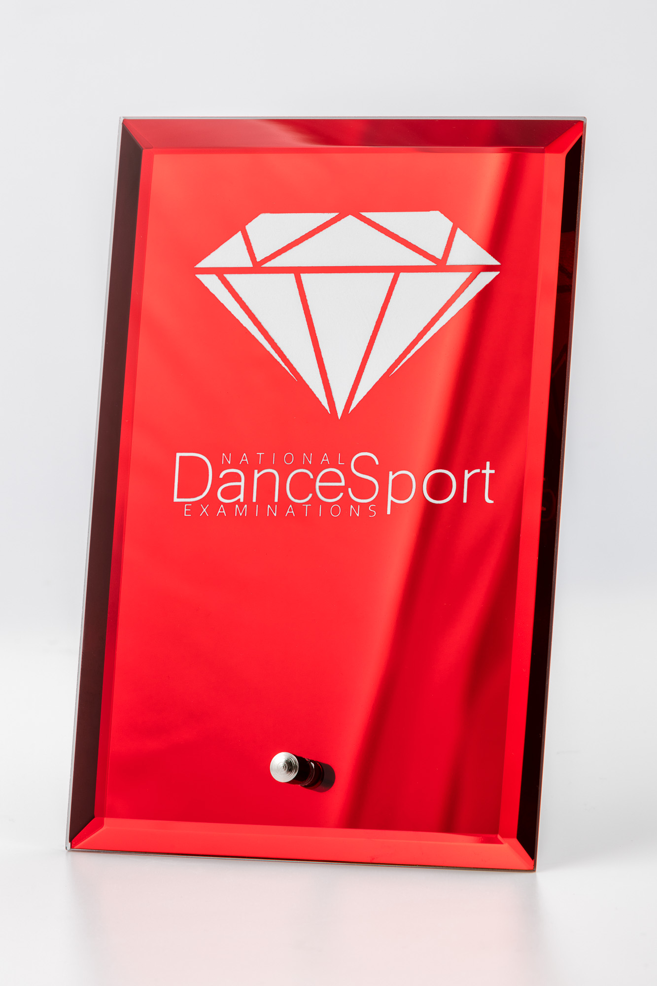 Product photography of dancing medal and plate - red plate