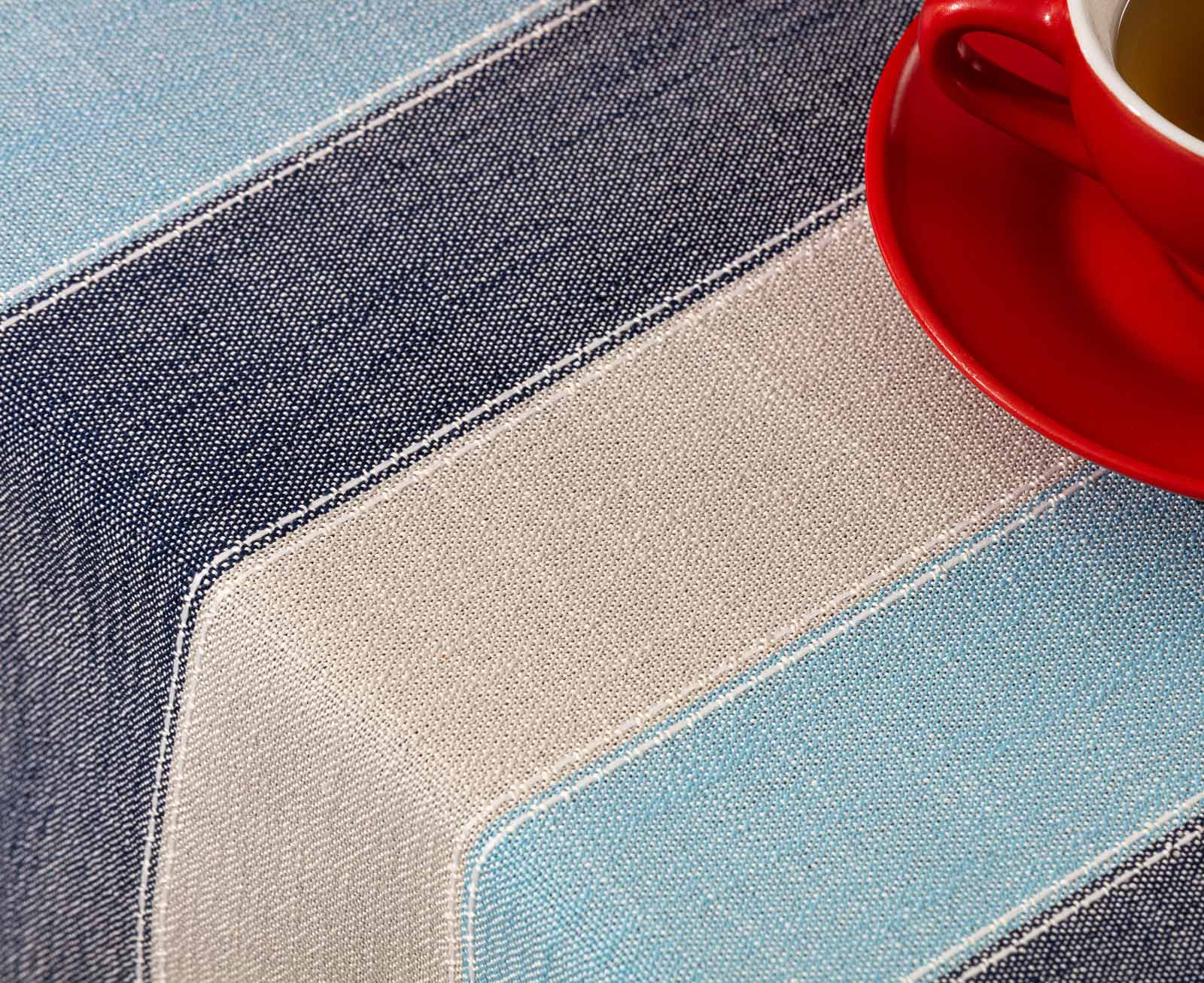 Table Cloth closeup with tea cup showing colour and texture - close-up product photography in studio sample