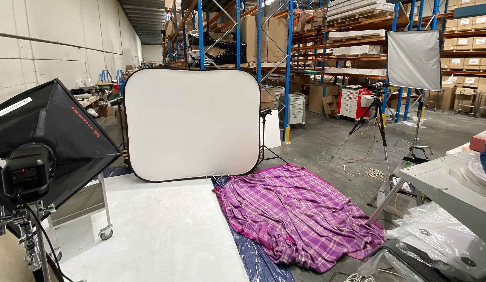 Warehouse client photoshoot showing extra large reflectors side view