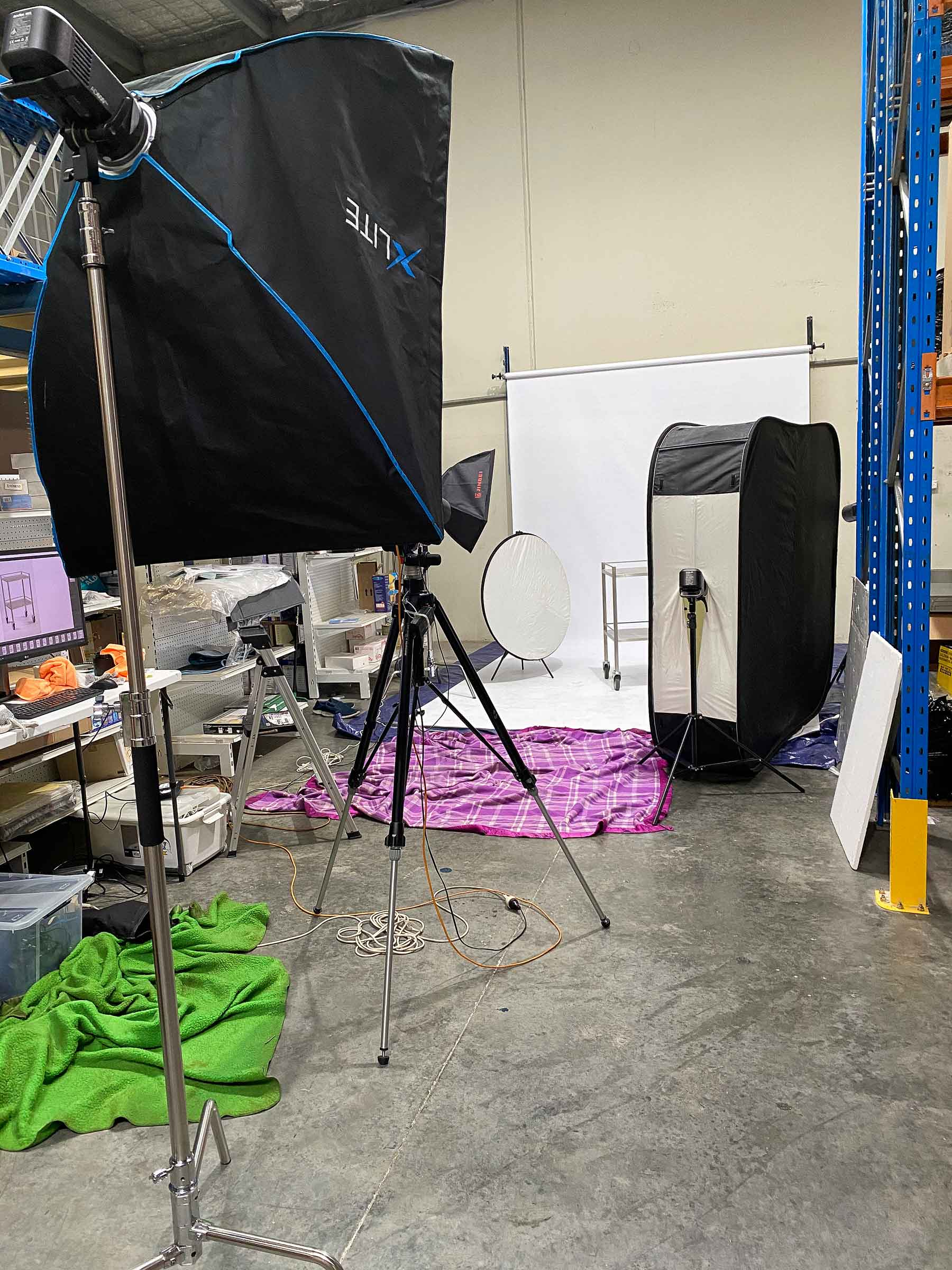 Warehouse client photo shoot showing extra large reflectors