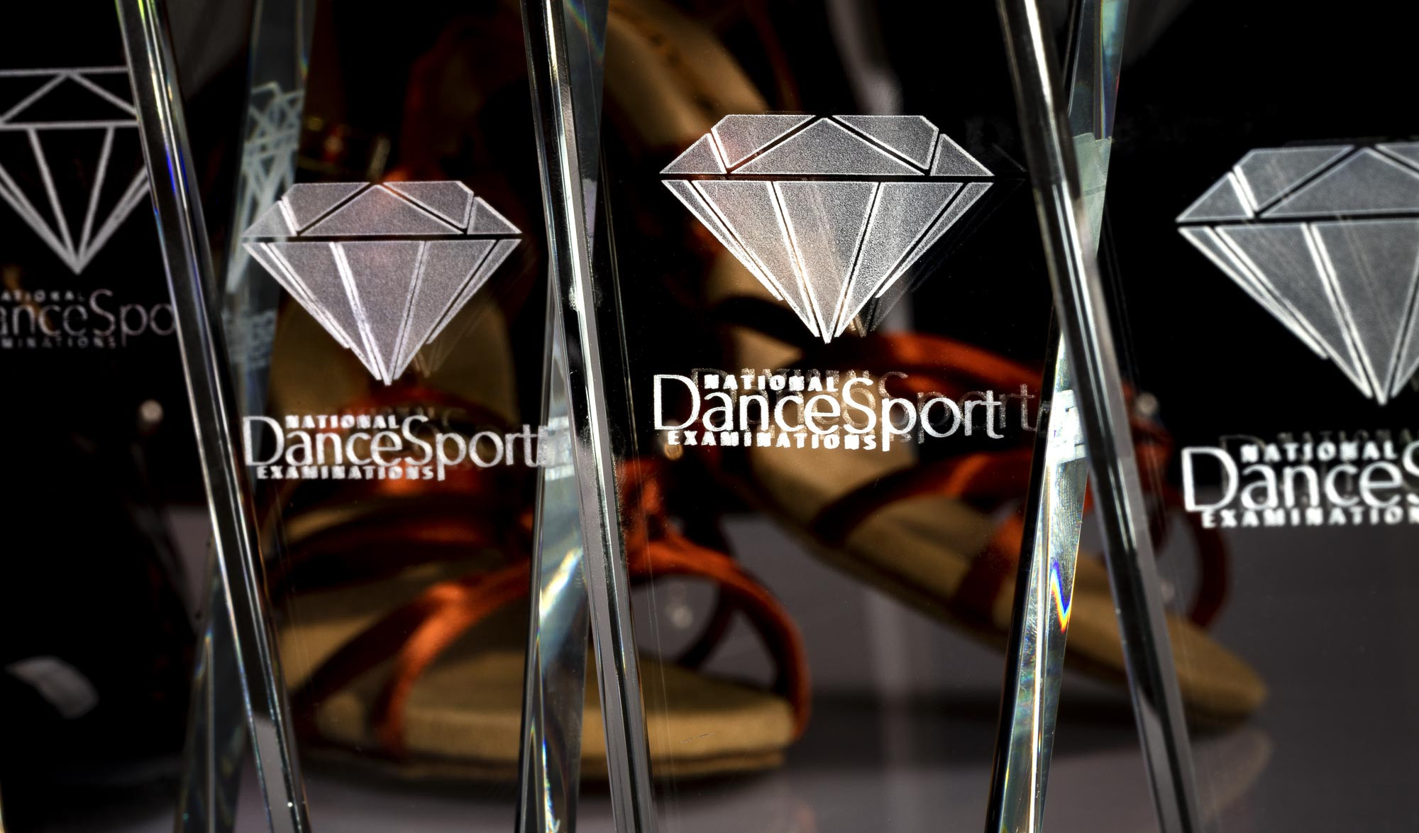 Lifestyle product photography of dancing medal and plate - close-up of trophies