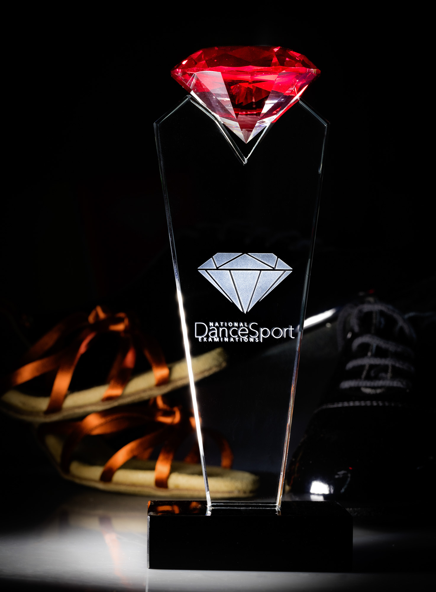 Lifestyle product photography of dancing medal and plate - red trophy